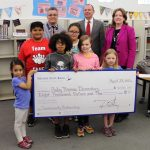 Nevada State Bank presents a check for $8,000 to Ruby Thomas Elementary School