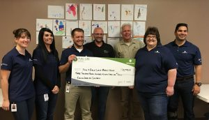 Southwest Gas, FUEL for LIFE, presented a check in the amount of $3,793.51 to Travis Crowder, chief professional officer for the Boys & Girls Clubs.