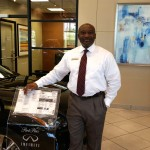 Arthur Okosi is a Park Place Infiniti sales manager with an easy smile and musical accent.