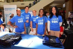 Employee volunteers from Cox Communications, Las Vegas, assist during one of the company's annual Back-To-School Fairs