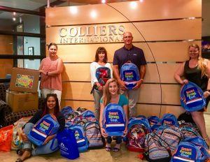Colliers International and their charitable foundation, Links for Life, partnered to donate more than forty backpacks and hundreds of school supplies.