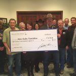 Nevada State Bank's Debby Herman presents check to Reno Rodeo Foundation