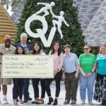 Las Vegas High School students in the JAG Nevada program visited Opportunity Village and presented the organization with a $500 check.