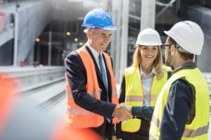 Executives greeting workers on a construction site. Bank of Nevada is ready to help you purchase, refinance or improve your real estate property for your business or investment portfolio.