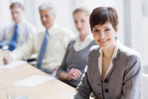 Office professionals sitting along a table in a conference room. Click to learn more about First Independent Bank's experienced banking counsel for your practice.