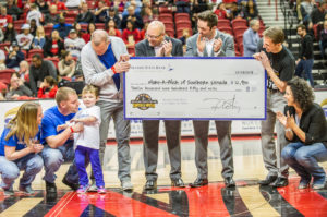 On Wednesday, Feb. 28, 2018, Nevada State Bank presented a check for $12,950 to Make-A-Wish Southern Nevada. The check was presented during halftime at the final home game for the UNLV Runnin' Rebels.