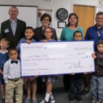 Nevada State Bank presented a check for $8,000 to Ruby Thomas Elementary School in celebration of Teach Children to Save (TCTS) and to support the school's education efforts.