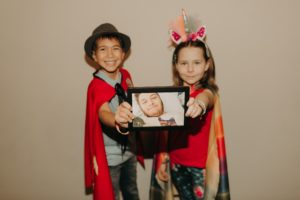 Candlelighters Superhero Ambassadors James Kish and Alexa Garin holding photo of Angel Ambassador Cooper Ricciardi - 0156 sm