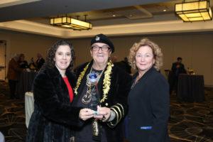 GLVAR leaders accept Platinum Global Achievement Award.