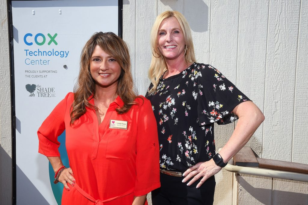 The Shade Tree Executive Director Linda Perez, left,  with Kim Salinas of Cox Business