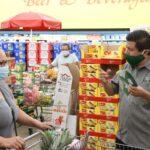 North Las Vegas Mayor Pro Tem Isaac Barron gives masks to customers at the La Bonita Supermarket.IMG_5041