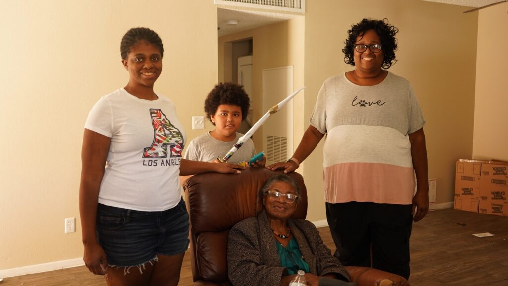 Tyria Smith and her family- recipents of a Move 4 Less Moving Our Community move sm